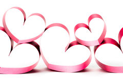 Ribbons shaped as hearts on white Royalty Free Stock Photography