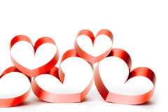 Ribbons shaped as hearts on white Stock Image