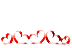 Ribbons shaped as hearts on white. Valentines day concept stock images