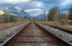 Ribbons of Steel 2. A set of railway tracks heading into the mountains Stock Photo