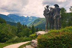Ribcev Laz, Slovenia - July 4, 2017: Town park close to Bohinj Lake with the Monument To Four Courageous Men - local. Ribcev Laz, Slovenia - July 4, 2017: Town Royalty Free Stock Photo