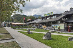 Ribcev Laz town center close to Bohinj Lake in Slovenia. People walk in town center with shops and restaurants. Ribcev Laz is a settlement on Lake Bohinj, most Stock Images