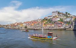 The Ribeira area and Douro river. Porto, Portugal. Porto, Portugal - June 18, 2018: Embankment Ribeira in old town and Douro river royalty free stock photography