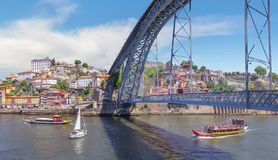 The Ribeira area and Douro river. Porto, Portugal. Porto, Portugal - June 18, 2018: Embankment Ribeira in old town, the Dom Luis I Bridge and Douro river royalty free stock photos