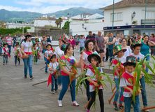 Cavalcade in Ribeira Grande, Sao Miguel island, Azores, Portugal. RIBEIRA GRANDE, AZORES, PORTUGAL - JUNE 29, 2017: Children at traditional cavalcade on central Royalty Free Stock Photo