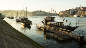 Ribeira, traditional boats at Douro river in Old Town, Luiz iron bridge in background Stock Photo
