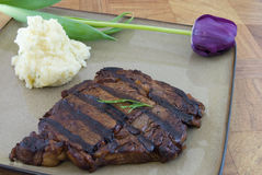 Ribeye Dinner. Steak and mashed potatoes on plate with tulip Stock Images