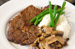Ribeye meal rice green beans and mushrooms Royalty Free Stock Images