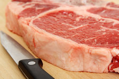 Ribeye steak. Close up of a ribeye steak and a knife Royalty Free Stock Photo