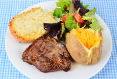 Ribeye Steak and Baked Potato Stock Photos
