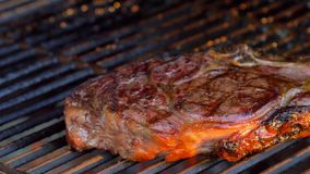 Ribeye steak on charcoal grill, 4K stock footage