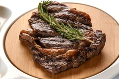 Ribeye steak decorated with a sprig of rosemary closeup stock photo