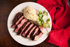 Ribeye steak dinner with mashed and caesar Stock Photos