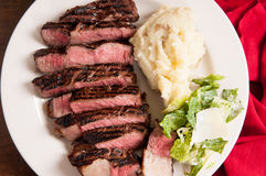 Ribeye steak dinner with mashed and caesar Stock Images