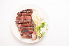 Ribeye steak dinner with mashed and caesar Royalty Free Stock Image