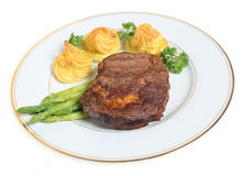 Ribeye steak and duchess potatoes Stock Images