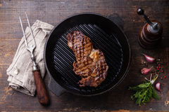 Ribeye steak entrecote on grill pan Royalty Free Stock Photography
