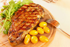 Ribeye steak with greenery Stock Images