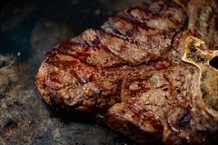 Ribeye steak on grill in meat restaurant stock photography