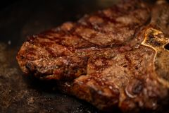 Ribeye steak on grill in meat restaurant stock image