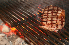 Ribeye steak on grille. In meat restaurant Stock Image