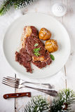Ribeye Steak on New Year's festive table Stock Photo