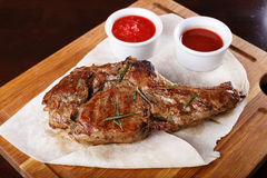 Ribeye steak with sauce. Ribeye steak on a wooden board with pita bread and sauce stock images