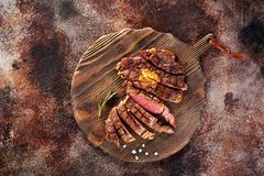 Ribeye steak slices on a wooden serving board stock photos