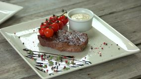 Ribeye steak with spices.
