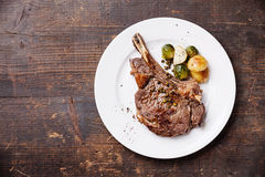 Ribeye Steak with vegetables. On dark wooden background Royalty Free Stock Photography
