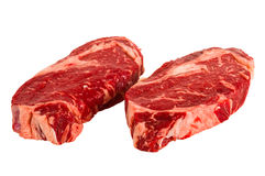 Ribeye steaks. Isolated on white background Stock Photos