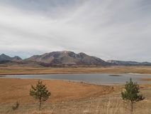 The Riblje Lake. Fish`s Lake and the panorama of The Durmitor Mountain at the background Stock Photos