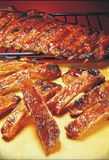 RIBS. BBQ BARBECUE RIBS FOOD PORK royalty free stock images