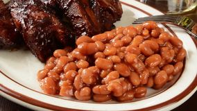 Ribs and baked beans stock footage