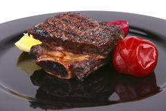 Ribs on black dish Stock Images