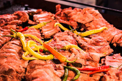 Ribs with chilli peppers on BBQ Royalty Free Stock Image
