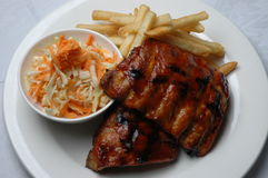Ribs & Chips. BBQ Ribs with chips & coleslaw Stock Image