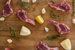 Ribs chops, lemon and garlic on wooden board Royalty Free Stock Images