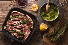 Ribs of lamb in saucepan and mashed potatoes in a ladle and beetroot sauce Royalty Free Stock Photo