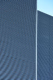 Ribs - metal wall paneling. Metal wall façade of an office building with ribs – detail of modern architecture stock images