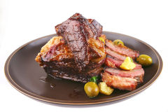 Ribs on old style ceramic dish Stock Photography