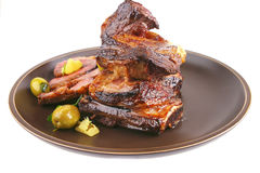 Ribs on old style dish over white Royalty Free Stock Images