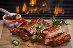 Ribs On A Flaming Hot Grill Royalty Free Stock Images