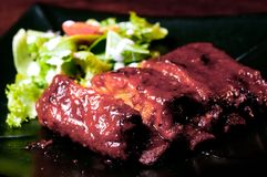 Ribs with salad Royalty Free Stock Photography
