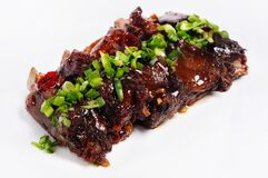 Ribs in sauce with green onions