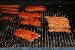Ribs, sausages and other pork specialties on grill. royalty free stock photo