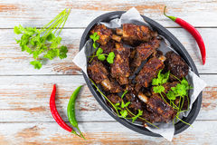 Ribs seasoned with spicy garlic ginger barbecue sauce amd cilant Royalty Free Stock Images