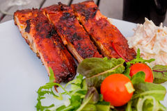 Ribs with some salad and coleslaw Royalty Free Stock Photo