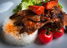 Ribs with stewed carrots and rice. royalty free stock image
