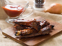 Ribs  with tomato sauce Royalty Free Stock Photo